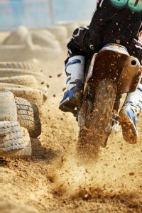 Motocross bike increase speed in track for championchip compettition.