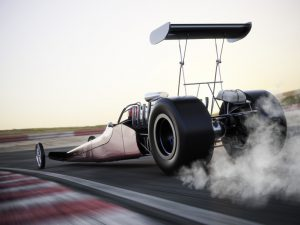 Dragster racing down the track with burnout. Photo realistic 3d model scene with room for text or copy space